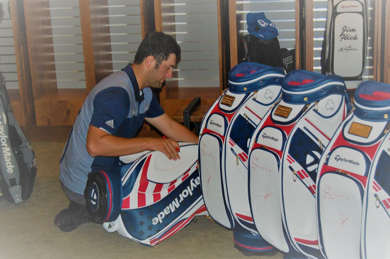 john-rahm-signs-golf-bag-for-ogo